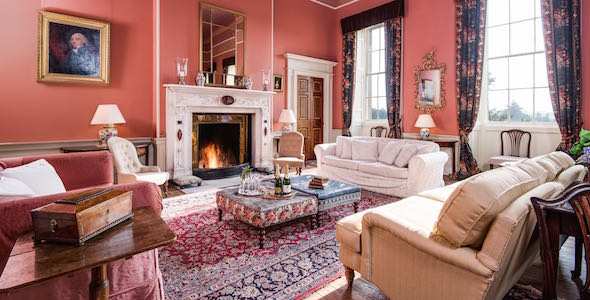 The drawing room is the principal reception room, with cosy furnishing and distant views across the South lawn.