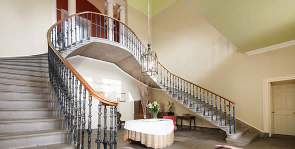The sweeping staircase at Wedderburn is the perfect place for making a grand entrance and for wedding photography
